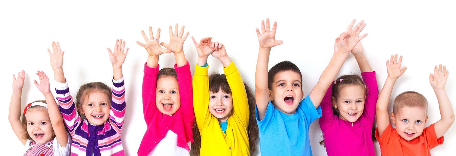 Children smiling with raising their hands.