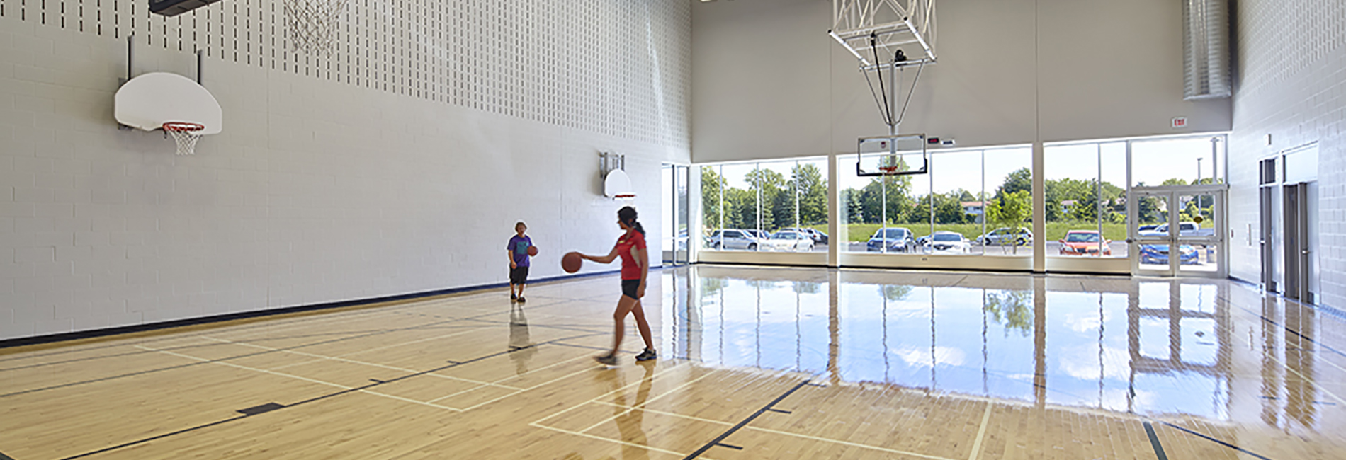 People playing basketball in the gymnasium. Photo credit: CS&P Architects